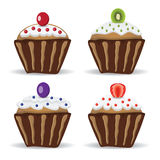 Set of four cupcakes with fruit Stock Photography