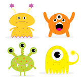Set of four cute cartoon monsters. Isolated. Happy Royalty Free Stock Image