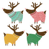 Set of four cute reindeers in amusing knitted Royalty Free Stock Images