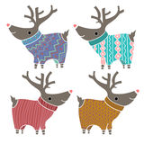Set of four cute reindeers in amusing knitted Stock Image