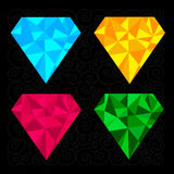 Set of four diamonds. Blue, yellow, pink and green. Black backgr Stock Photography