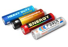 Set of four different AA batteries. Close view of four different AA batteries isolated over white Royalty Free Stock Photo