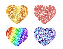 Set of four different colored hand drawn tribal tattoo hearts. Vector illustration stock illustration