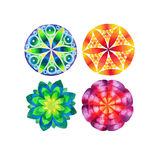 Set of four different colored mandalas Stock Photo