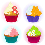 Set of four different yummy cupcake for International Women`s day with flowers for your design in cartoon style. Vector Stock Photos