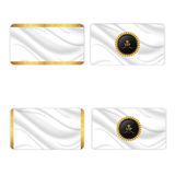 Set of four elegant silk business cards with a gold border and a VIP tag. Stock Photos