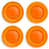 Set of four empty plates with a different design. Royalty Free Stock Images