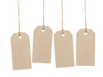 Set of four empty tag on waxed cord with space for writing something Royalty Free Stock Images