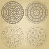 Set of four ethnic swirly round borders patterns on grunge Stock Images