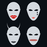 Set of four faces, masks an abstract style. Stock Image