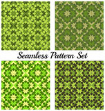 Set of four fashionable geometric seamless patterns with rhombus, square, triangle and star shapes of green shades Royalty Free Stock Photo