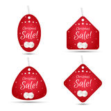 Set of four festive Christmas coupon tags, red with white balls. Suitable for web design and print. Royalty Free Stock Image