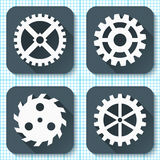 Set of four flat gear icons with long shadows on a graph engineering paper background. Royalty Free Stock Photos