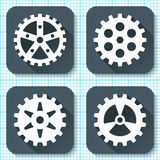 Set of four flat gear icons with long shadows on a graph paper background. Royalty Free Stock Images