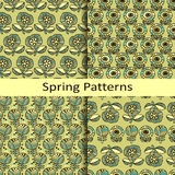 Set of four floral hand drawn spring patterns Royalty Free Stock Photos
