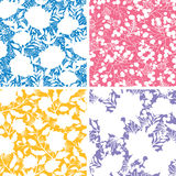 Set of four floral silhouettes seamless patterns Stock Photo