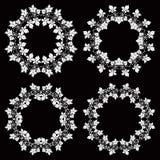 Set of four floral vintage round frames on black background Stock Photo