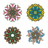Set of four flower circle mandalas Royalty Free Stock Photo