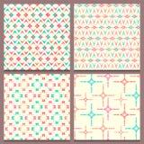 Set of four geometric seamless patterns  Stock Photos
