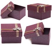 Set of four gift boxes purple with bow and ribbon Stock Images