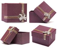 Set of four gift boxes purple with bow and ribbon Stock Photos