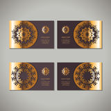 Set of four golden floral ornamental cards with oriental mandala Stock Images