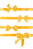 Set of four golden ribbon gift bows. Isolated on white Stock Photo