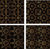 Set of four golden seamless pattern. Royalty Free Stock Image