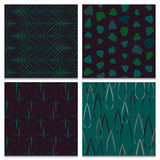Set of four green and brown forest seamless patterns Stock Photos
