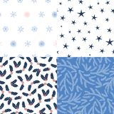 Seamless Christmas patterns. Set of four hand drawn seamless vector patterns with fir tree branches, stars, snowflakes, holly leaves, berries. Design concept for Royalty Free Stock Photos