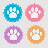 Set of four labels with paw print. Card. Vector illustration