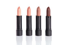 Set of four lipsticks in glamorous colors Royalty Free Stock Photos