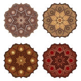 Set with four Mandalas in chocolate colors. Vector ornaments, round decorative elements for your design Stock Images