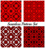 Set of four modern geometric seamless patterns with rhombus, square, triangle and star shapes of red, black and white shades Royalty Free Stock Photography