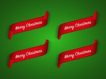 Set of four modern red christmas ribbons on green background Royalty Free Stock Images