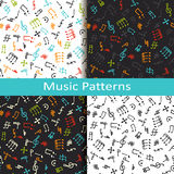 Set of four music patterns with different musical symbols Royalty Free Stock Image