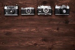 A set of four old-fashioned cameras with a copy space Royalty Free Stock Photo
