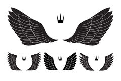 Set of four pairs of wings with crowns. Vector illustration. Stock Images