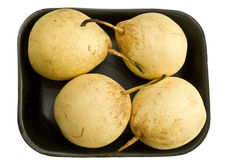 A set of four pears. On a black stay isolated on white royalty free stock image