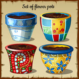 Set of four pots in the most unusual colors Stock Images