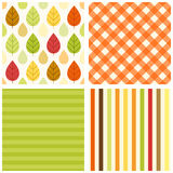 Set of four primitive retro seamless patterns with leaves and rain drops, gingham and striped Royalty Free Stock Photo