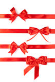 Set of four red ribbon satin bows. Isolated on white Stock Photo