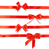 Set of four red ribbon satin bows Royalty Free Stock Photos