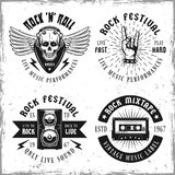 Set of four rock music vector emblems or labels. Set of four rock music vector emblems, labels, badges or logos in vintage style  on background with removable Royalty Free Stock Photography