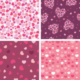 Set of four romantic hearts seamless patterns Stock Images