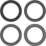Set of four round  frames in tire traces style. Royalty Free Stock Photos