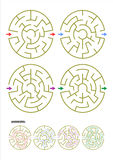 Set of four round maze game templates with answers stock photos
