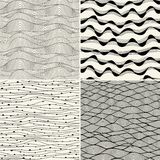 Set of four seamless abstract hand-drawn pattern, waves backgrou Royalty Free Stock Photo
