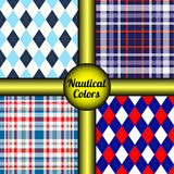 Set of four seamless argyle & tartan plaid patterns in nautical / naval palette. Stock Images