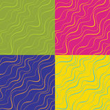 Set of four seamless backgrounds with multicolored waves Royalty Free Stock Image